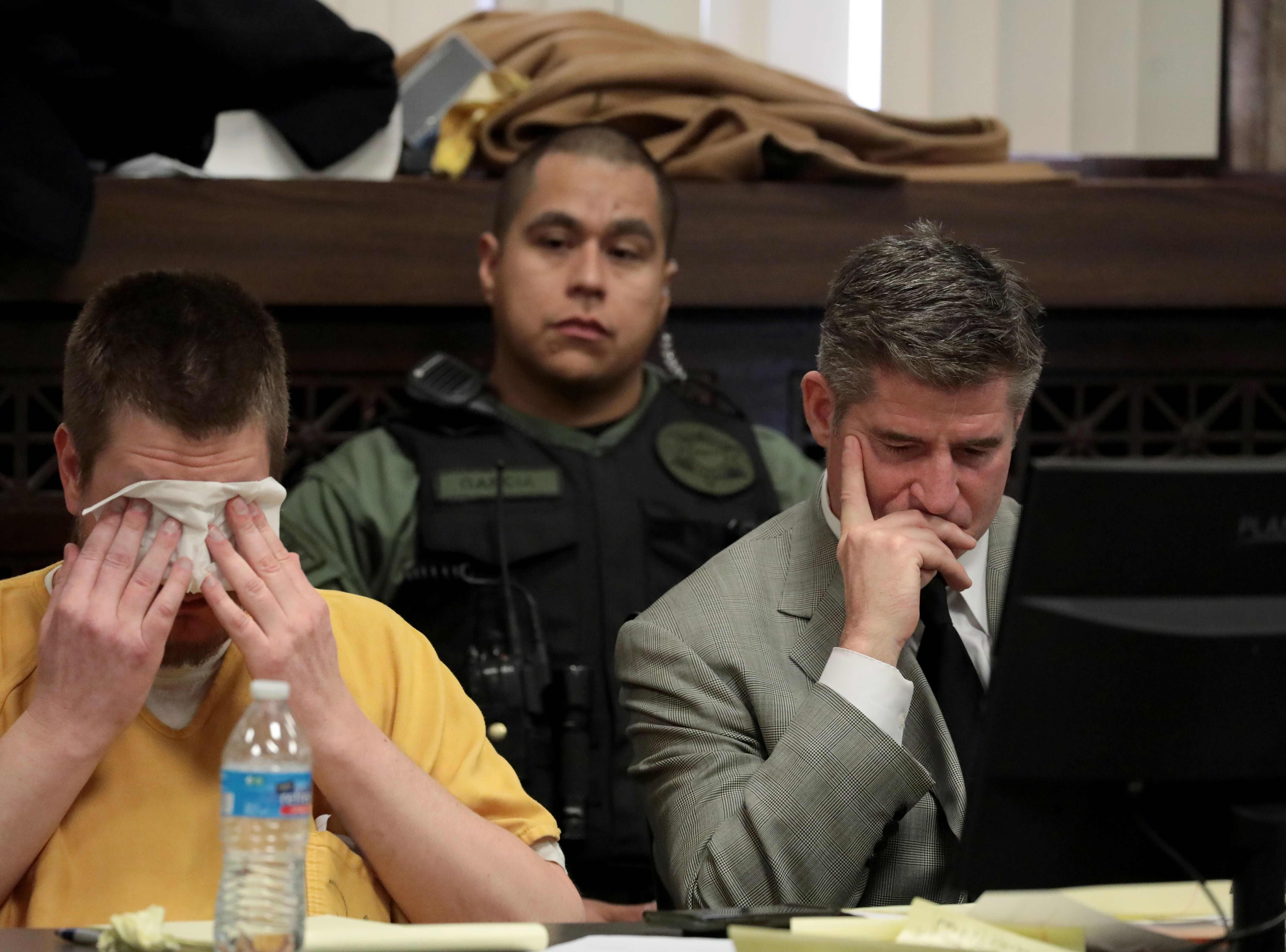 Former Chicago police Officer Jason Van Dyke, left,reacts during his sentencing hearing at the Leighton Criminal Court Building on Jan. 18, 2019 in Chicago. Van Dyke was sentenced to six years and nine months for the 2014 fatal shooting of 17-year-old African-American Laquan McDonald.