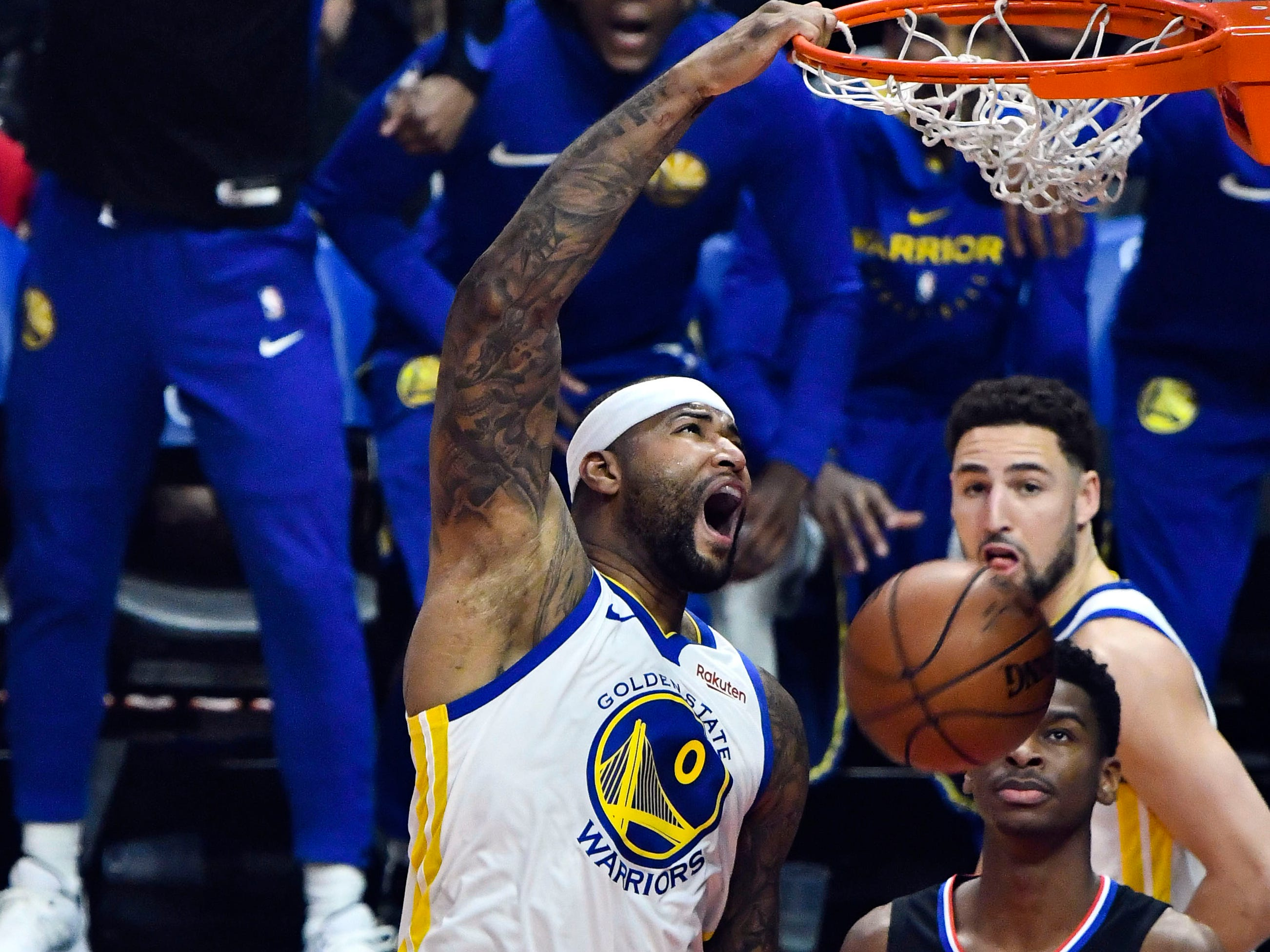 Jan. 18: Warriors center DeMarcus Cousins throws down a one-handed slam for his first points in his season debut against the Clippers in Los Angeles.