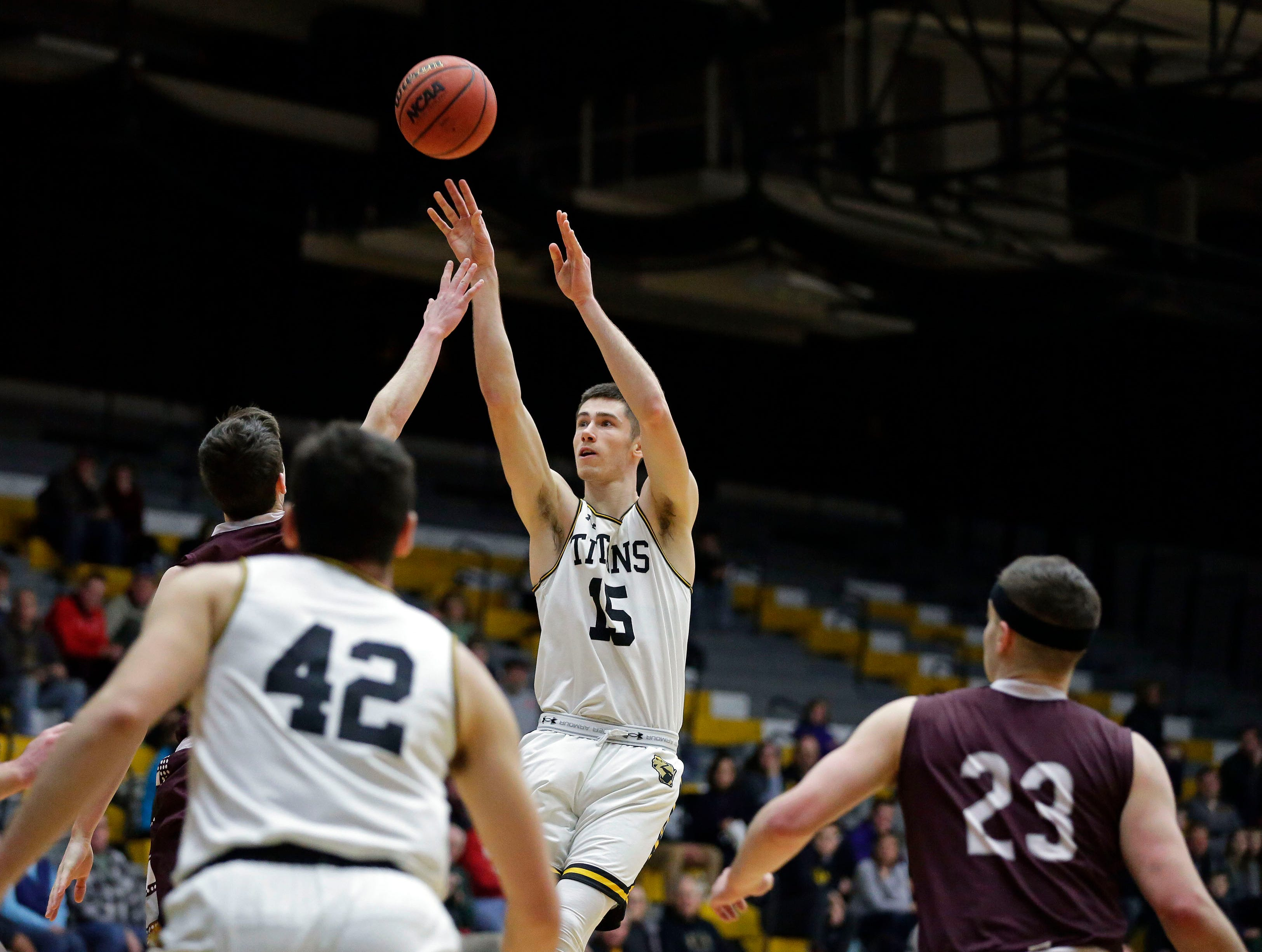 Adam Fravert of UW-Oshkosh shoots over the defense of UW-La Crosse in Wisconsin Intercollegiate Athletic Conference basketball Saturday, January 19, 2019, at Kolf Sports Center in Oshkosh, Wis. 