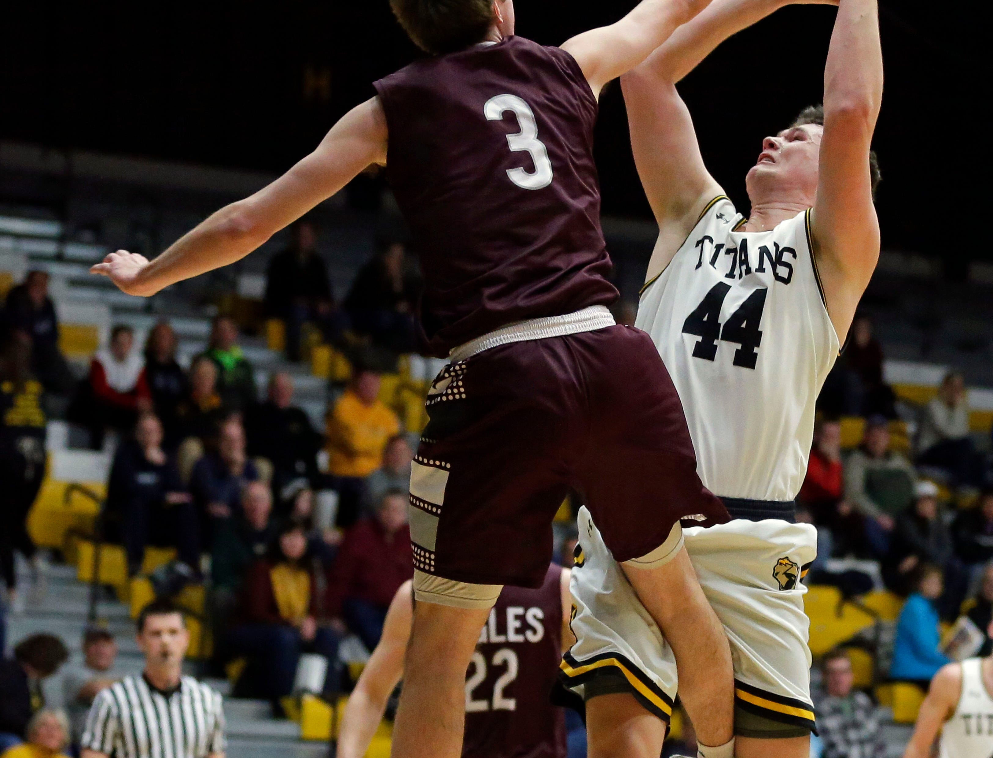 Sam Skoyen of UW-La Crosse defends against Jack Flynn of UW-Oshkosh in Wisconsin Intercollegiate Athletic Conference basketball Saturday, January 19, 2019, at Kolf Sports Center in Oshkosh, Wis. 