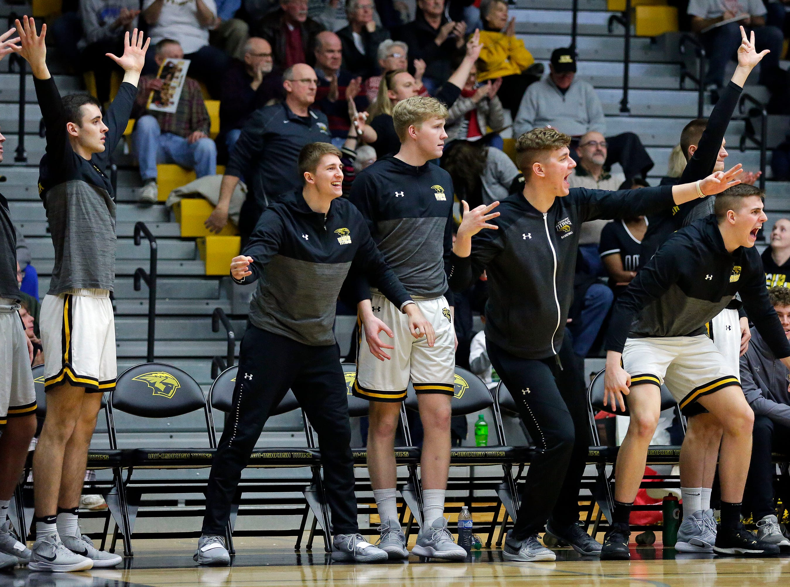 UW-Oshkosh celebrates a three as the Titans take on UW-La Crosse in Wisconsin Intercollegiate Athletic Conference basketball Saturday, January 19, 2019, at Kolf Sports Center in Oshkosh, Wis. 