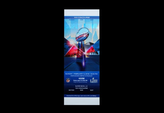 Studio photograph of a game ticket for Super Bowl LIII which will be played on February 3, 2019 at Mercedes-Benz Stadium in Atlanta, Georgia.