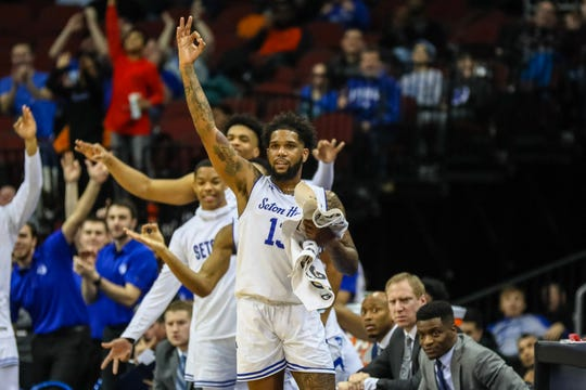 Seton Hall' sMyles Powell reacts to a Myles Cale 3-pointer against DePaul.