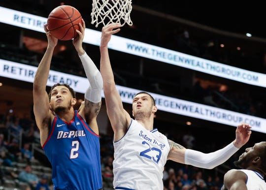 DePaul Blue Demons forward Jaylen Butz (2) fights with Seton Hall Pirates forward Sandro Mamukelashvili (23)