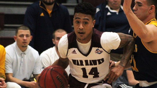 McMurry's Trevin Ramirez drives baseline during the War Hawks game against Howard Payne on Saturday.