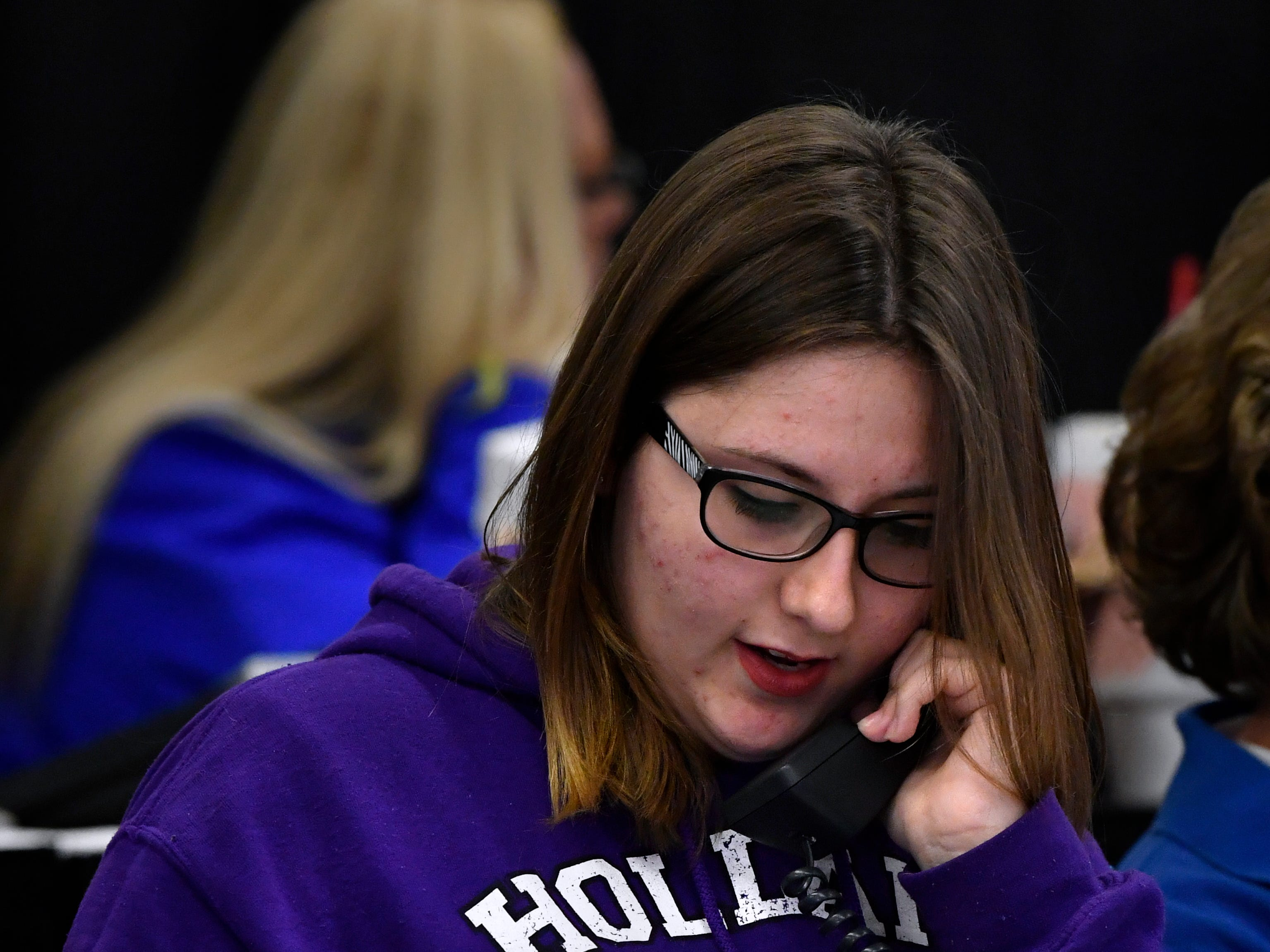 Kaylee Jones takes calls during the auction Saturday at the West Texas Rehabilitation 2019 Telethon & Auction Jan. 20, 2019. This was the 49th year for the benefit.