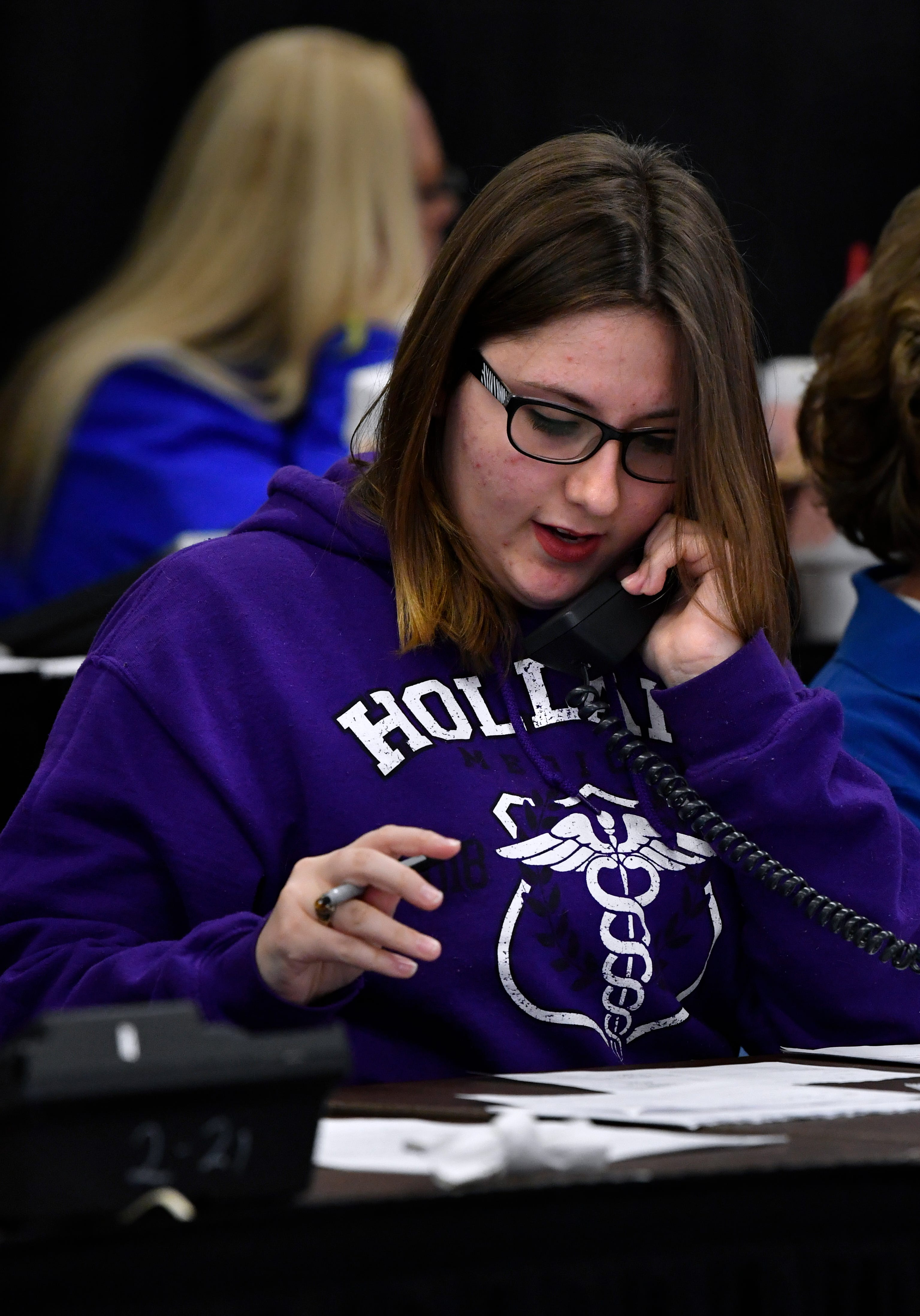 Kaylee Jones takes calls during the auction Saturday at the West Texas Rehabilitation 2019 Telethon & Auction. This was the 49th year for the benefit.