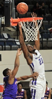 ACU's Jalone Friday, right, jumps for a rebound while a Northwestern State player defends. ACU beat the Demons 78-69 in the Southland Conference game Saturday, Jan. 19, 2019, at Moody Coliseum.