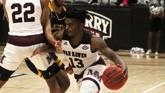 McMurry's Zacc Carter (13) drives off a screen from Mike Williams Jr. (22) during the War Hawks game against Howard Payne on Saturday, Jan., 19, 2019.