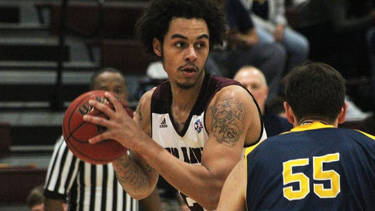 McMurry's Jordan Jackson (23) posts up during the War Hawks game against Howard Payne on Jan. 19.