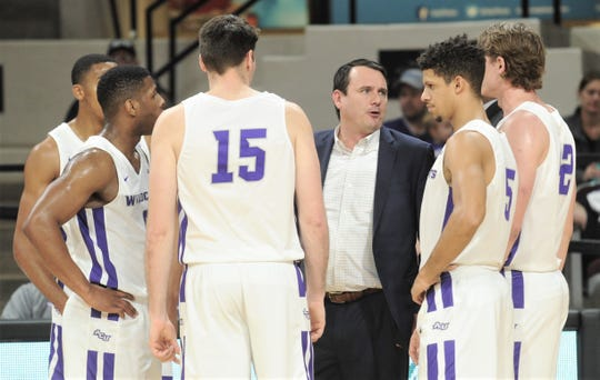 ACU coach Joe Golding, center, talks to his team during a break against Northwestern State. ACU beat the Demons 78-69 in the Southland Conference game Saturday, Jan. 19, 2019, at Moody Coliseum.