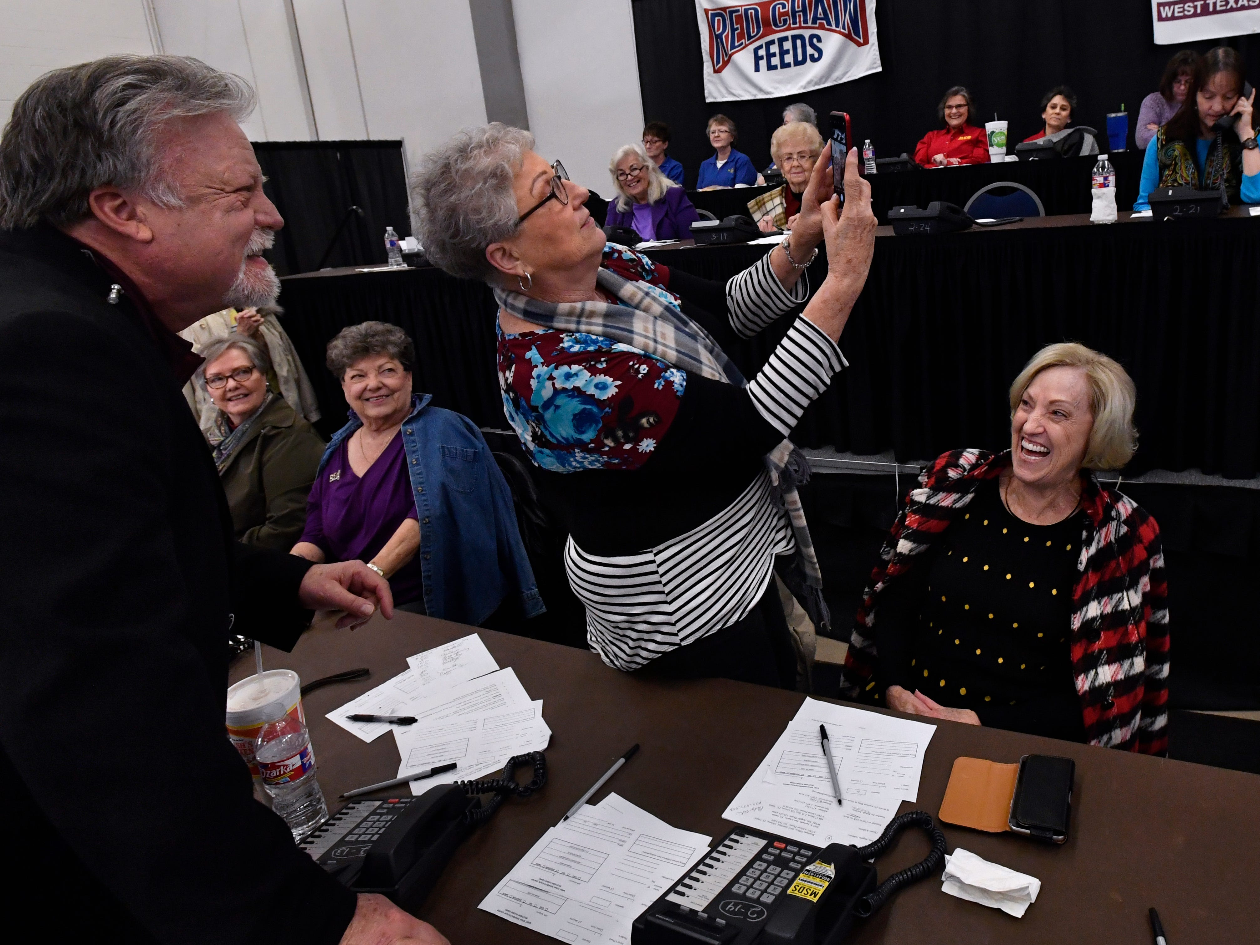 Connie Harris takes a selfie with actor Brad Maule during Saturday's West Texas Rehabilitation 2019 Telethon & Auction Jan. 20, 2019. This was the 49th year for the benefit.