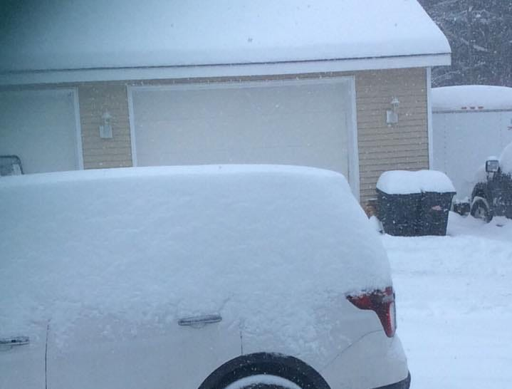 A reader's vehicle is covered in snow as a winter storm hits the Binghamton area.