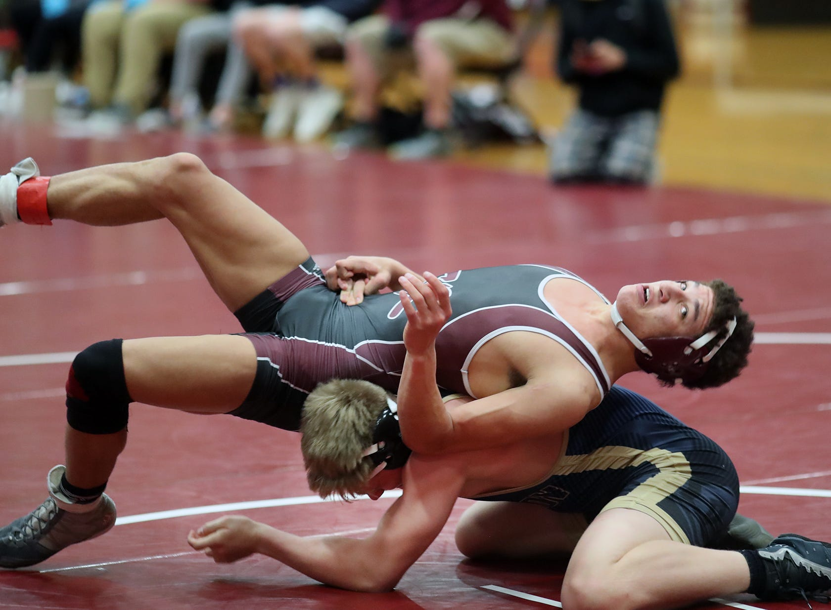 South Kitsap hosted its wrestling invitational Saturday, Jan. 1, 2019. They won the team title, and had nine wrestlers in the finals. Deyondre Davis, of South Kitsap does a spin move escape from Shaine Arzberger of Rogers in a 160 pound finals match.