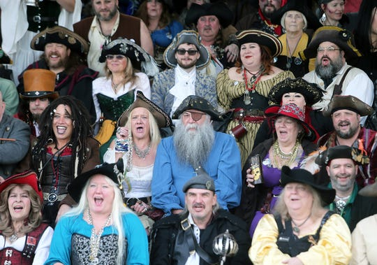 Pirates gave out a yell during a group photo in Port Orchard's Waterfront Park as part of the A Pirate's Life For Us festival on Saturday, January 19, 2019.
