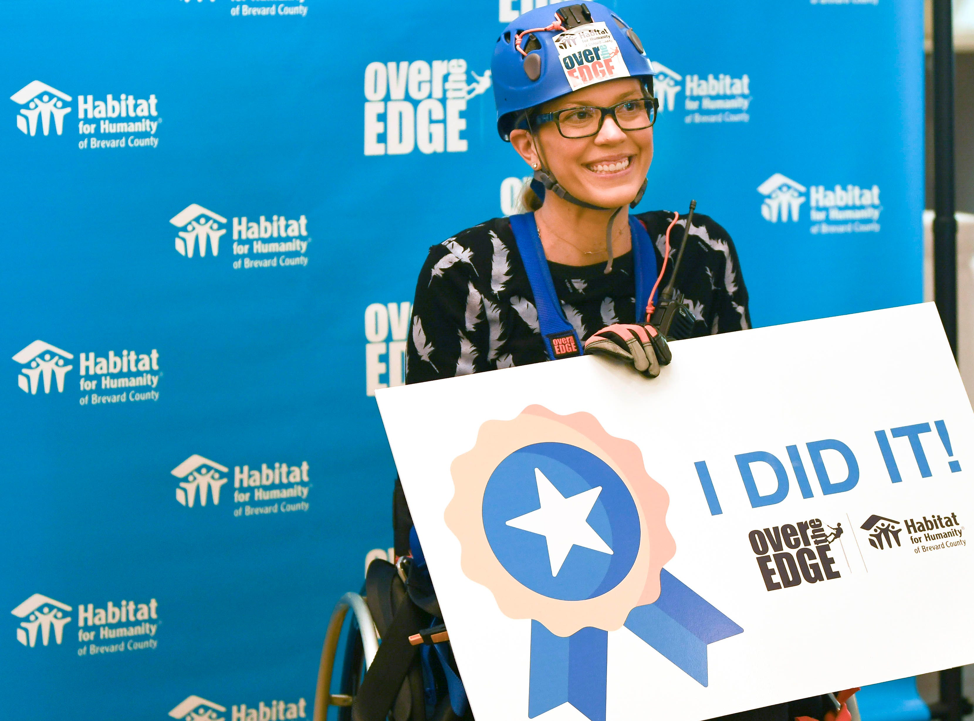 Jessica Andre goes Over the Edge at the Melbourne Rialto Hilton on Saturday morning. Over the Edge is a fundraiser for Habitat Humanity of Brevard, an organization that helps low-income families buy affordable houses. Teams and individuals raised money for the chance to rappel eight stories down the Hilton.
