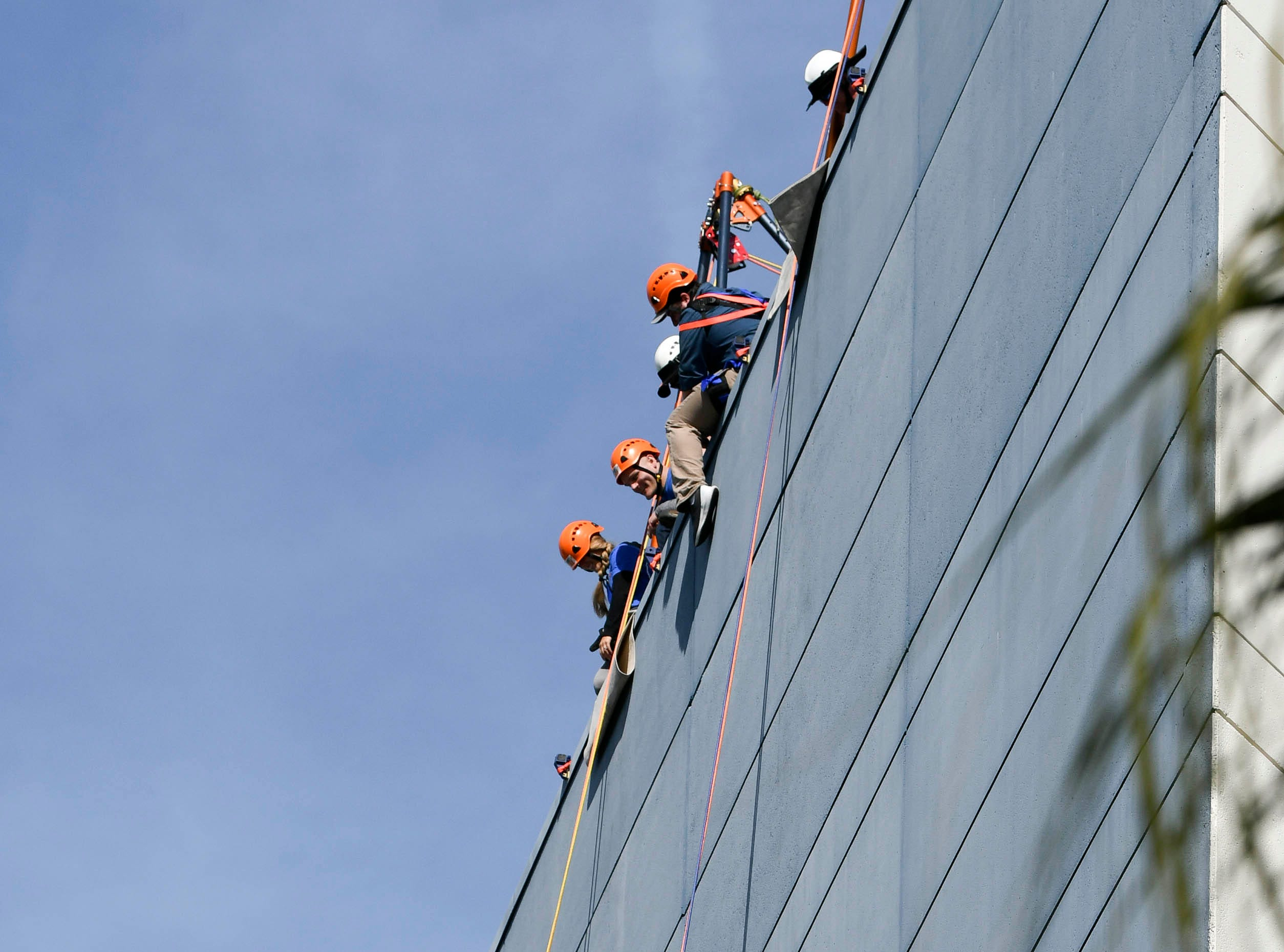 Participants in the Over the Edge fundraiser rappel down the building at the Melbourne Rialto Hilton on Saturday morning. Over the Edge is a fundraiser for Habitat Humanity of Brevard, an organization that helps low-income families buy affordable houses. Teams and individuals raised money for the chance to rappel eight stories down the Hilton.
