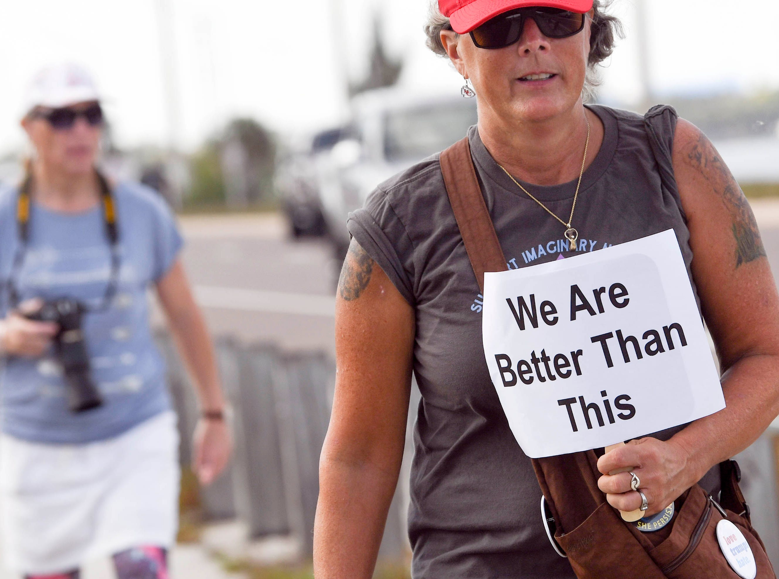 Hundreds of people walk the Eau Gallie Causeway in Melbourne, FL during a local observance of the national Women's March.