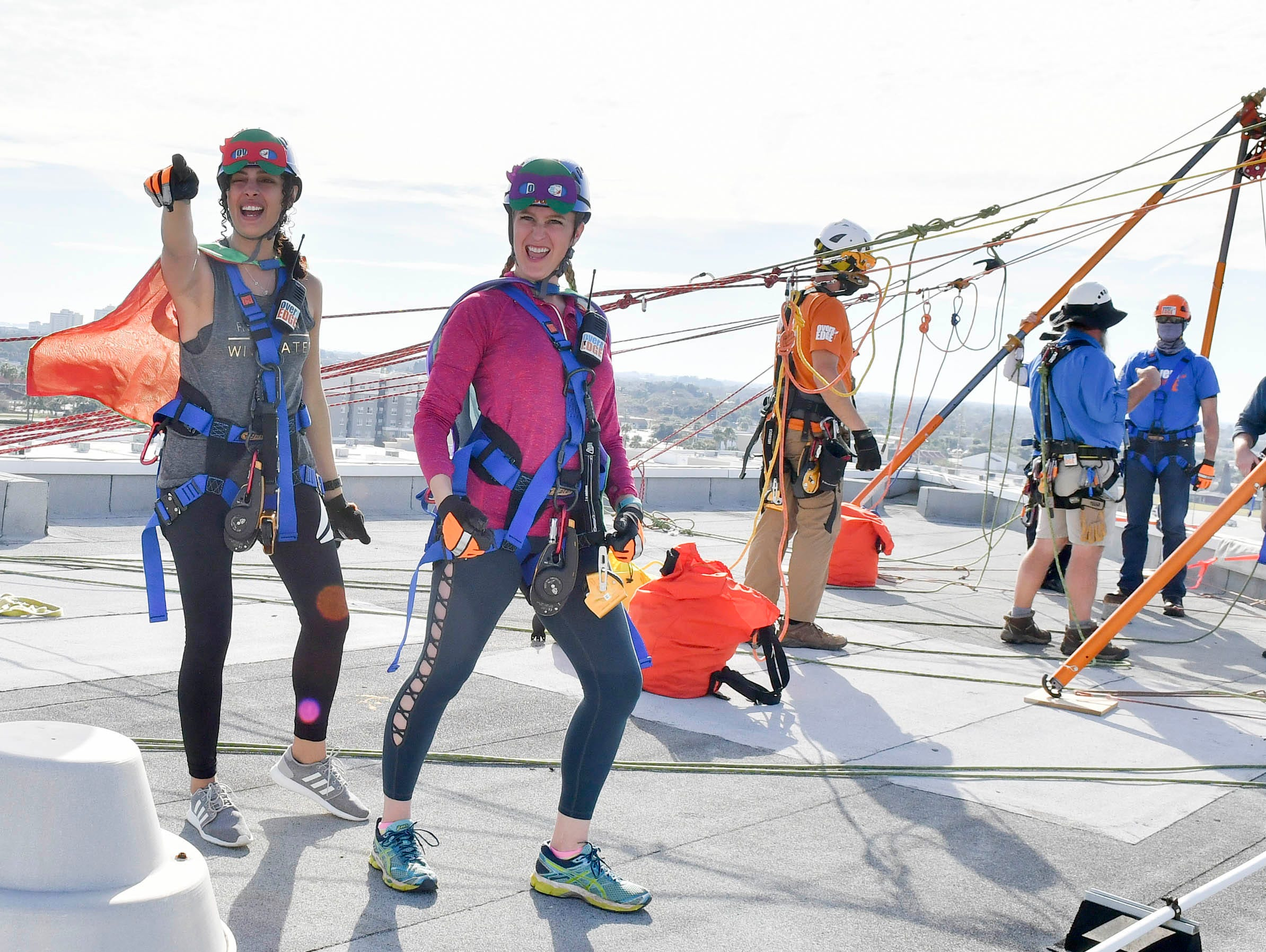 Participants in the Over the Edge fundraiser arrive on the roof at the Melbourne Rialto Hilton on Saturday morning. Over the Edge is a fundraiser for Habitat Humanity of Brevard, an organization that helps low-income families buy affordable houses. Teams and individuals raised money for the chance to rappel eight stories down the Hilton.