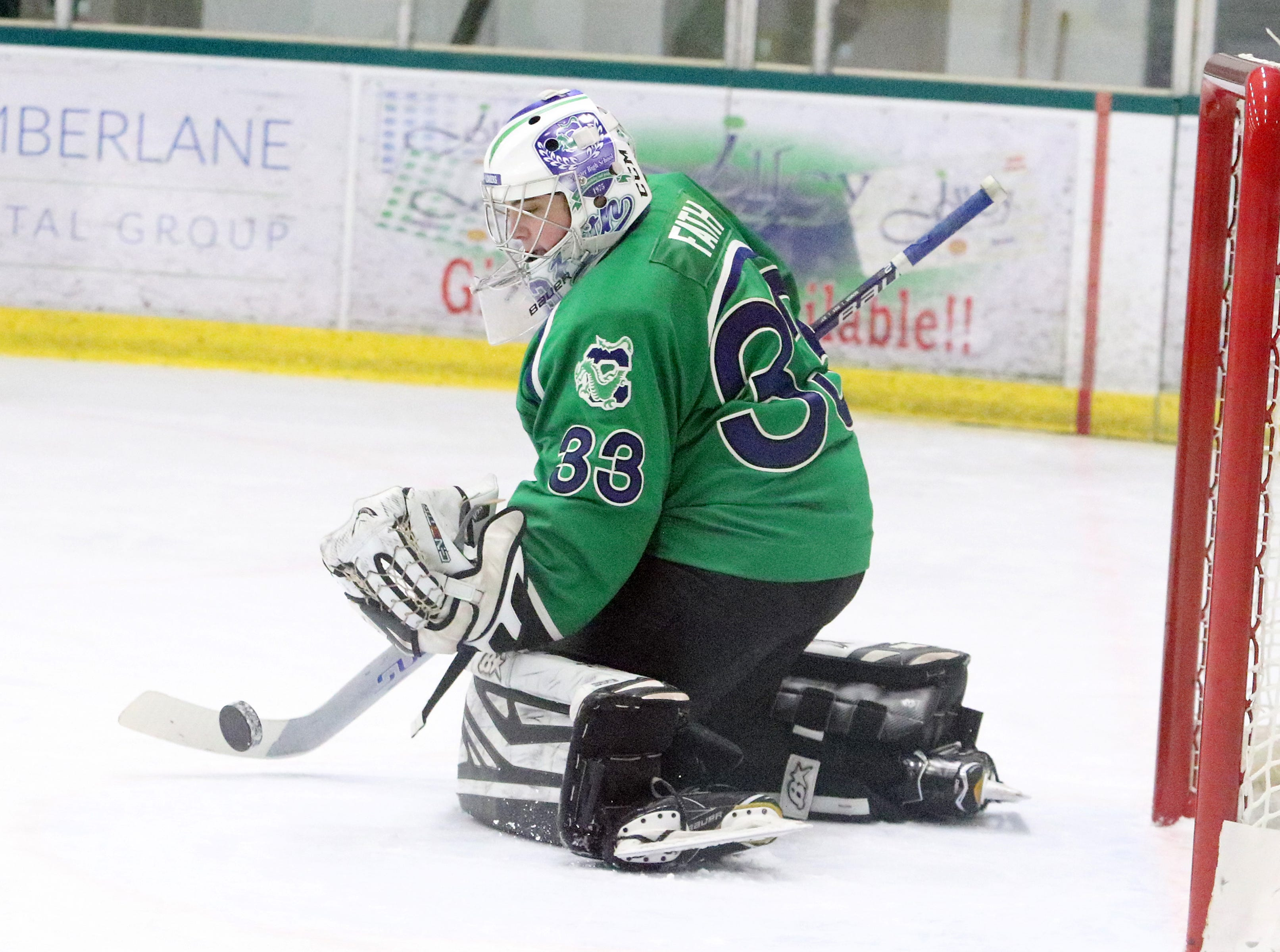 """Colchester senior Sam Fath makes a stick save during the Lakers 6-0 win over Burlington. Fath pitched a shutout during the 2nd annual """"BAHA Cup"""" game at Leddy Arena."""