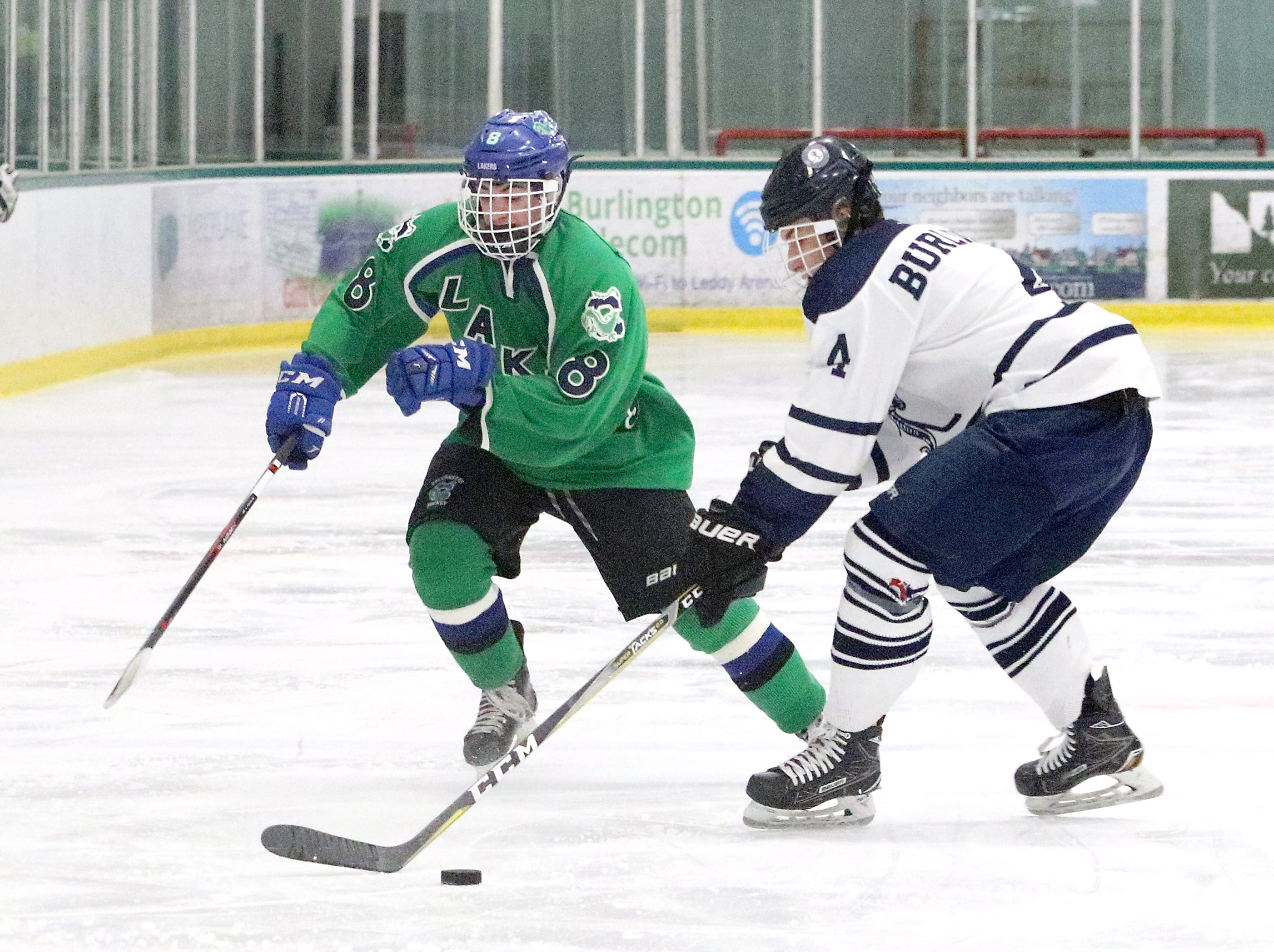 """Burlington's Colton Poulin and Colchester's Will Spencer battle for the puck during the Lakers 6-0 win on Saturday. The Lakers claimed the 2nd annual """"BAHA Cup"""" which features former BAHA teammates now playing for CHS and BHS."""