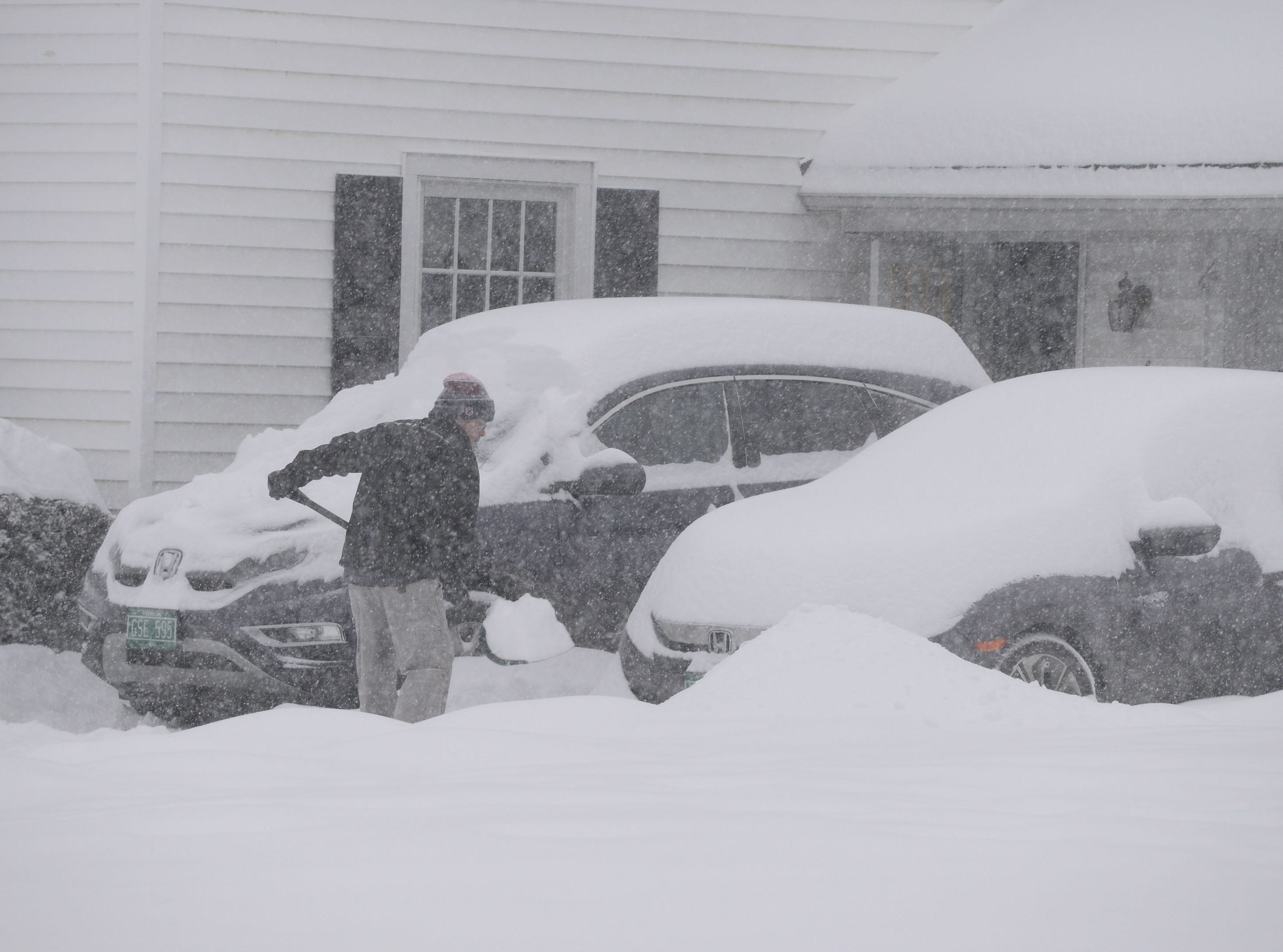 Getting an early start on clearing the driveway Sunday morning on Brewer Parkway, Jan. 20, 2019. The winter storm, dubbed Harper by the Weather Channel, swept into Vermont Saturday night and was expected drop as much as 24 inches of snow by Sunday evening.