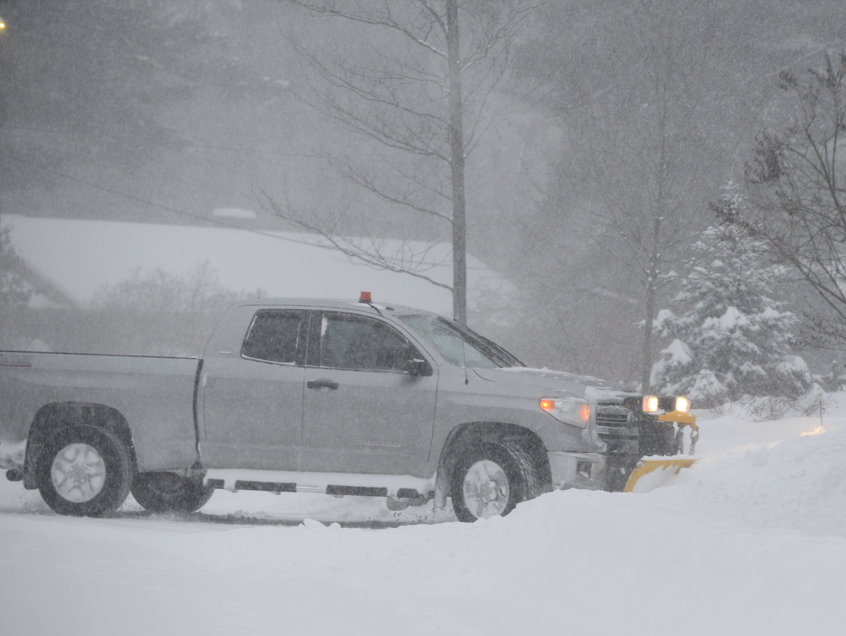A snowplow clears a drives on Brewer Parkway Sunday morning, Jan. 20, 2019. The winter storm, dubbed Harper by the Weather Channel, swept into Vermont Saturday night and was expected drop as much as 24 inches of snow by Sunday evening.