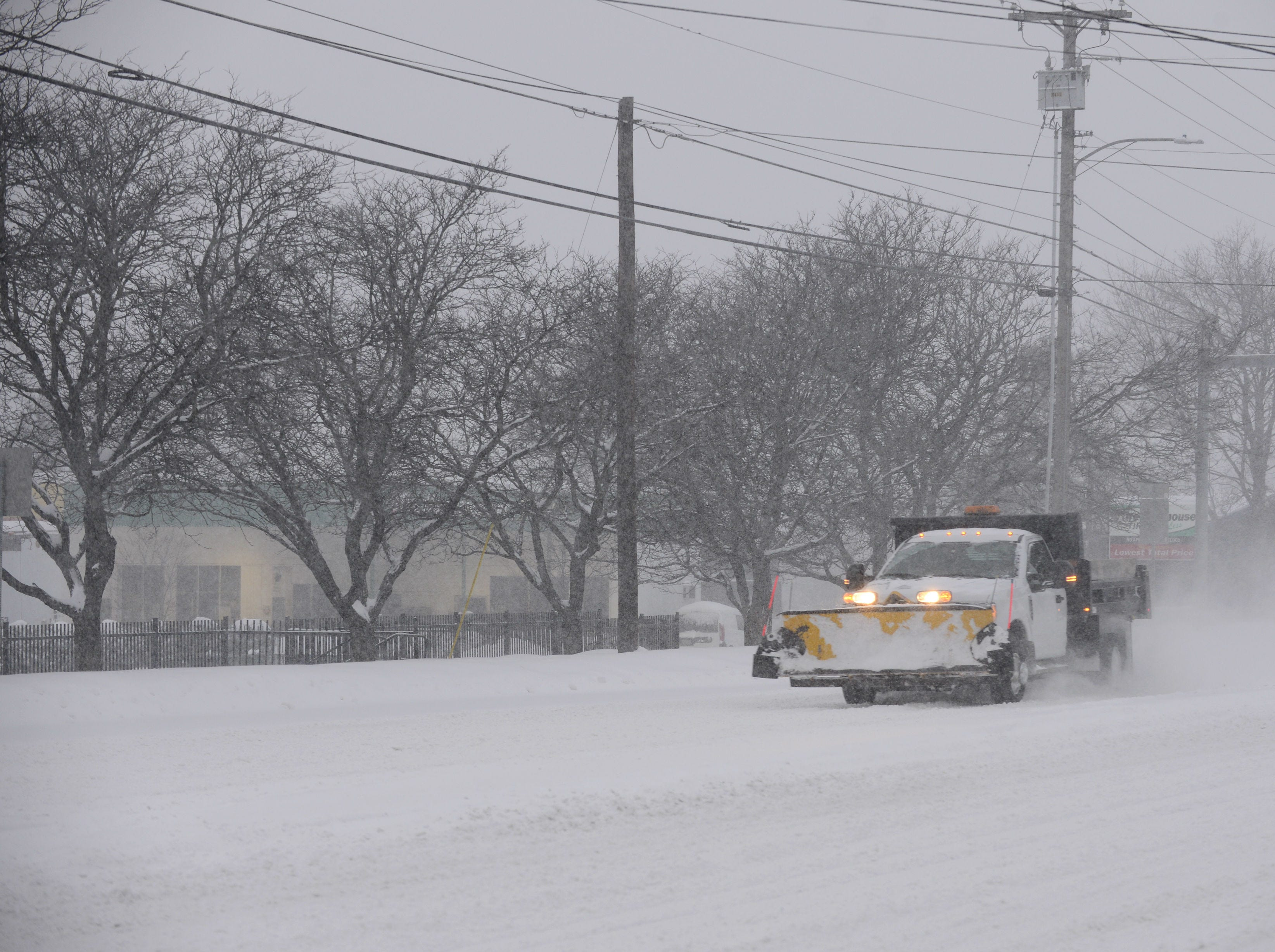 A snowplow makes its way south on Shelburne Road Sunday morning on Jan. 20, 2019. The winter storm, dubbed Harper by the Weather Channel, swept into Vermont Saturday night and was expected drop as much as 24 inches of snow by Sunday evening.