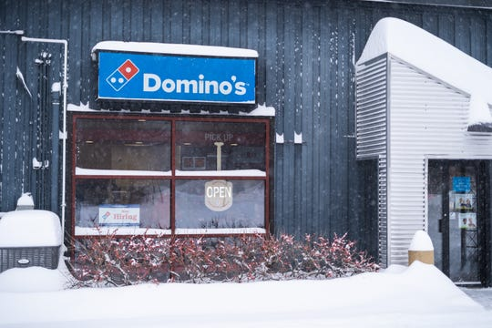 The Domino's Pizza on Farrell Street in South Burlington remains open during the storm Sunday afternoon, Jan. 20, 2019.
