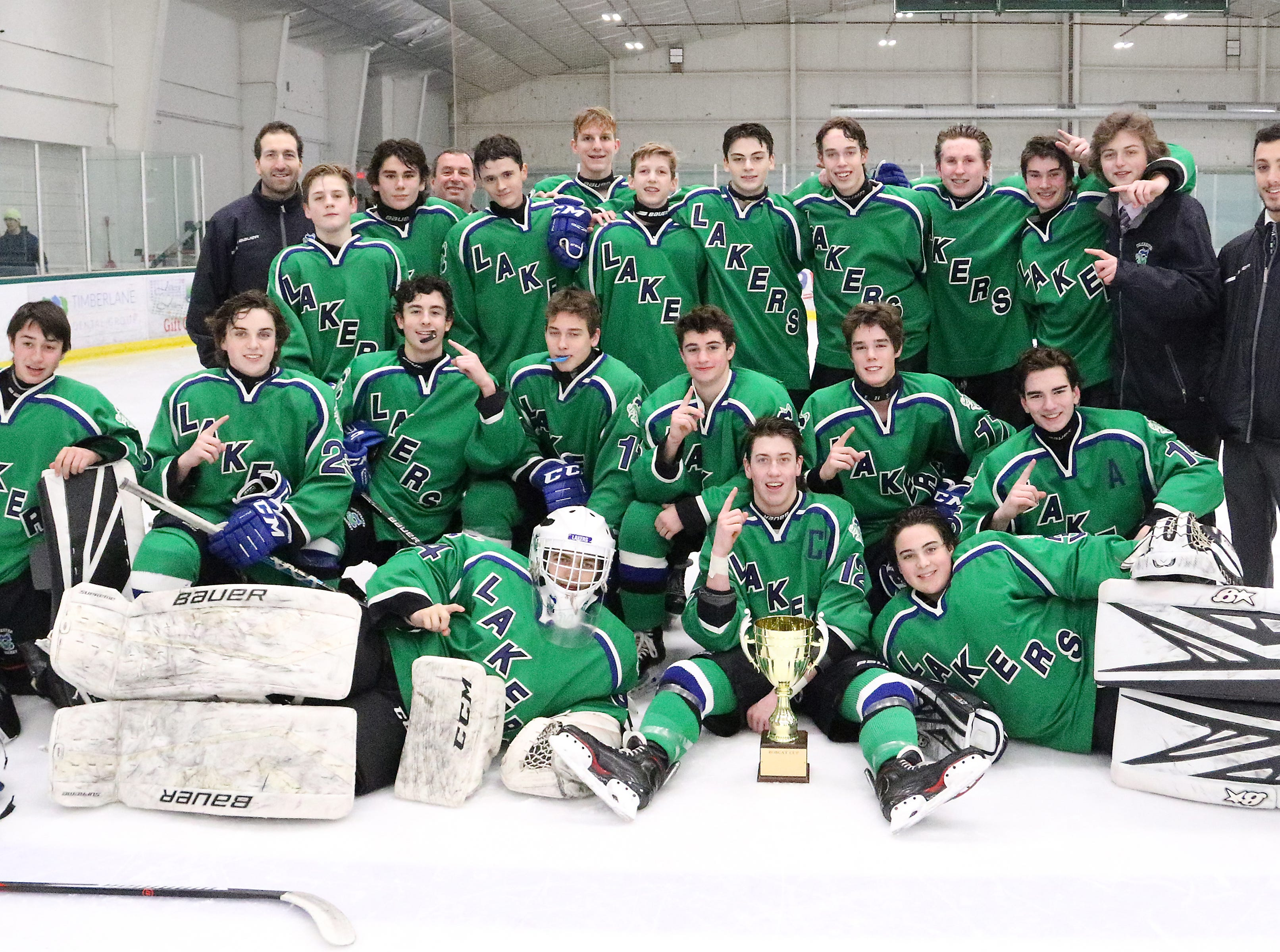 """The Colchester Lakers pose with the """"BAHA Cup"""" after defeating Burlington 6-0 in the 2nd annual game featuring former BAHA youth hockey teammates who are now high school rivals."""