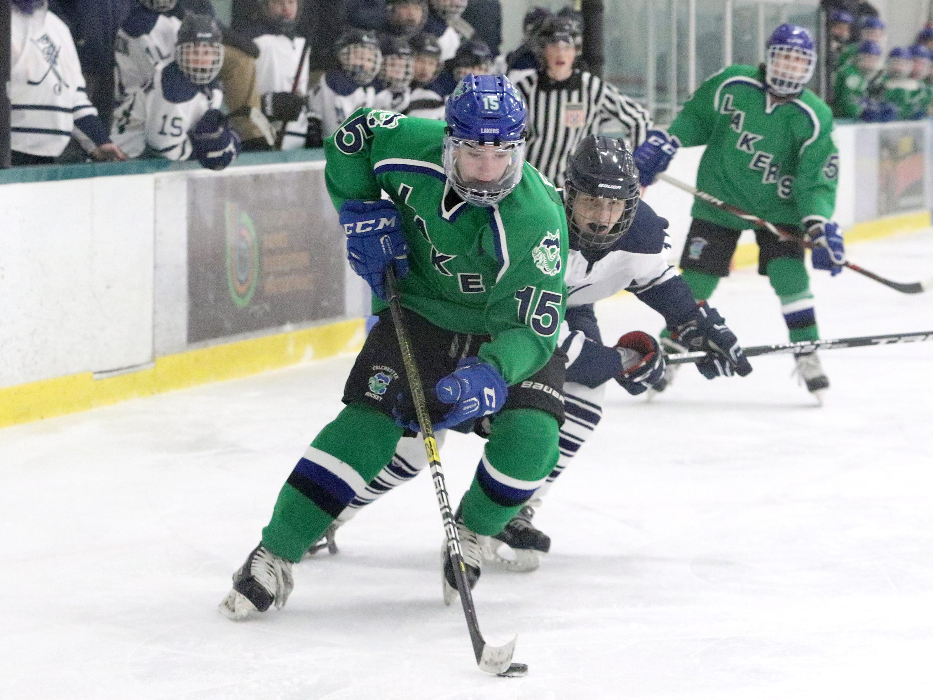 CHS defender Andy Rosato pushes the puck up the ice during the Lakers 6-0 win over BHS on Saturday. Rosato netted two of the LAker goals in the runaway win.