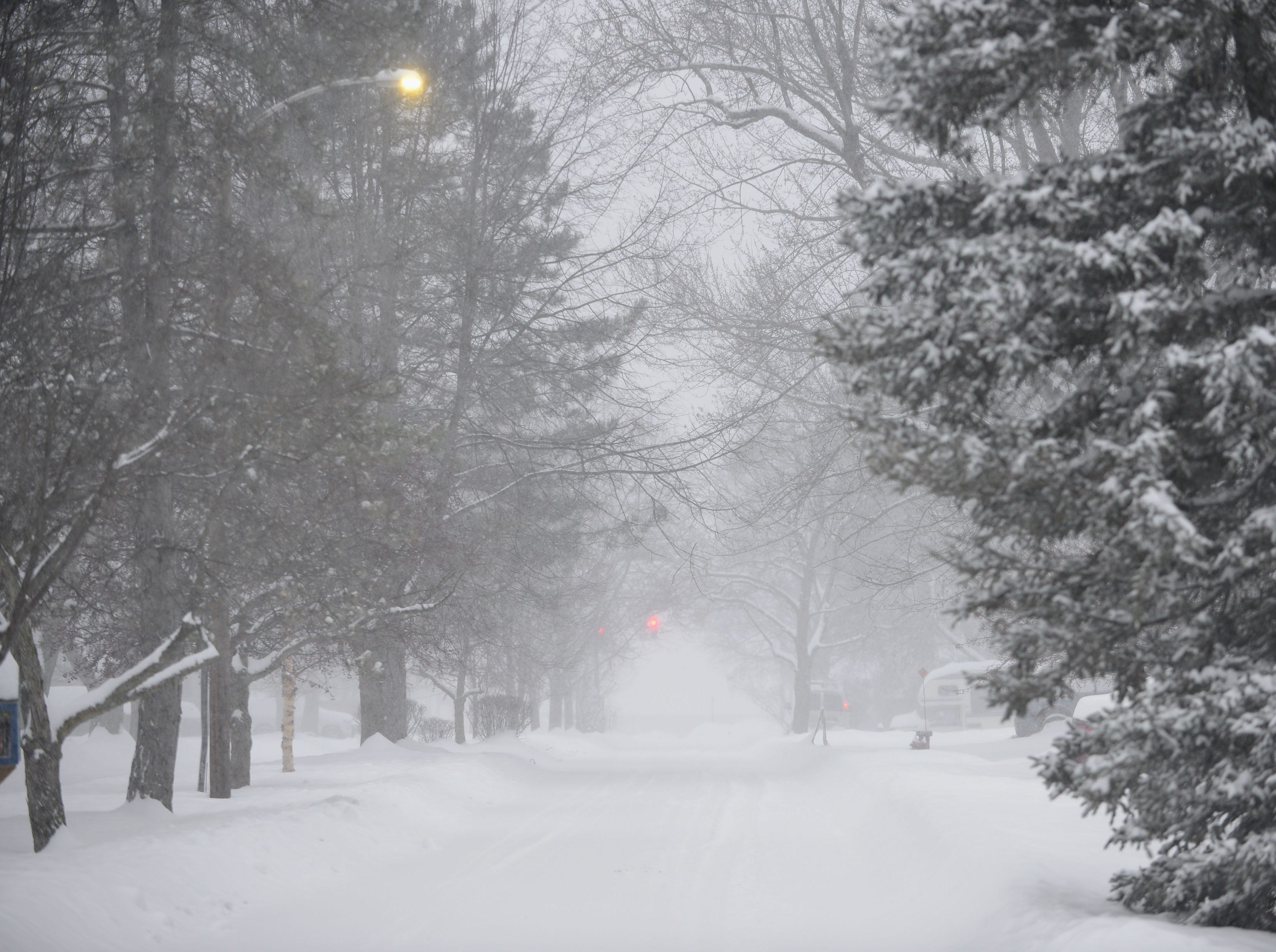 Blowing and falling snow dims the view down Brewer Parkway toward Shelburne Road in South Burlington Sunday morning, Jan. 20, 2019. The winter storm, dubbed Harper by the Weather Channel, swept into Vermont Saturday night and was expected drop as much as 24 inches of snow by Sunday evening.