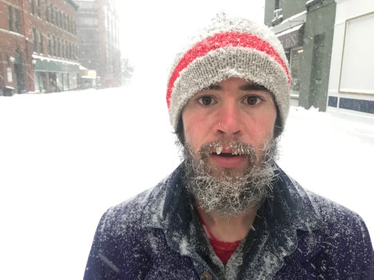 Ryan Dodelin navigates Church Street in downtown Burlington, Vermont, on the morning of Jan. 20, 2019.