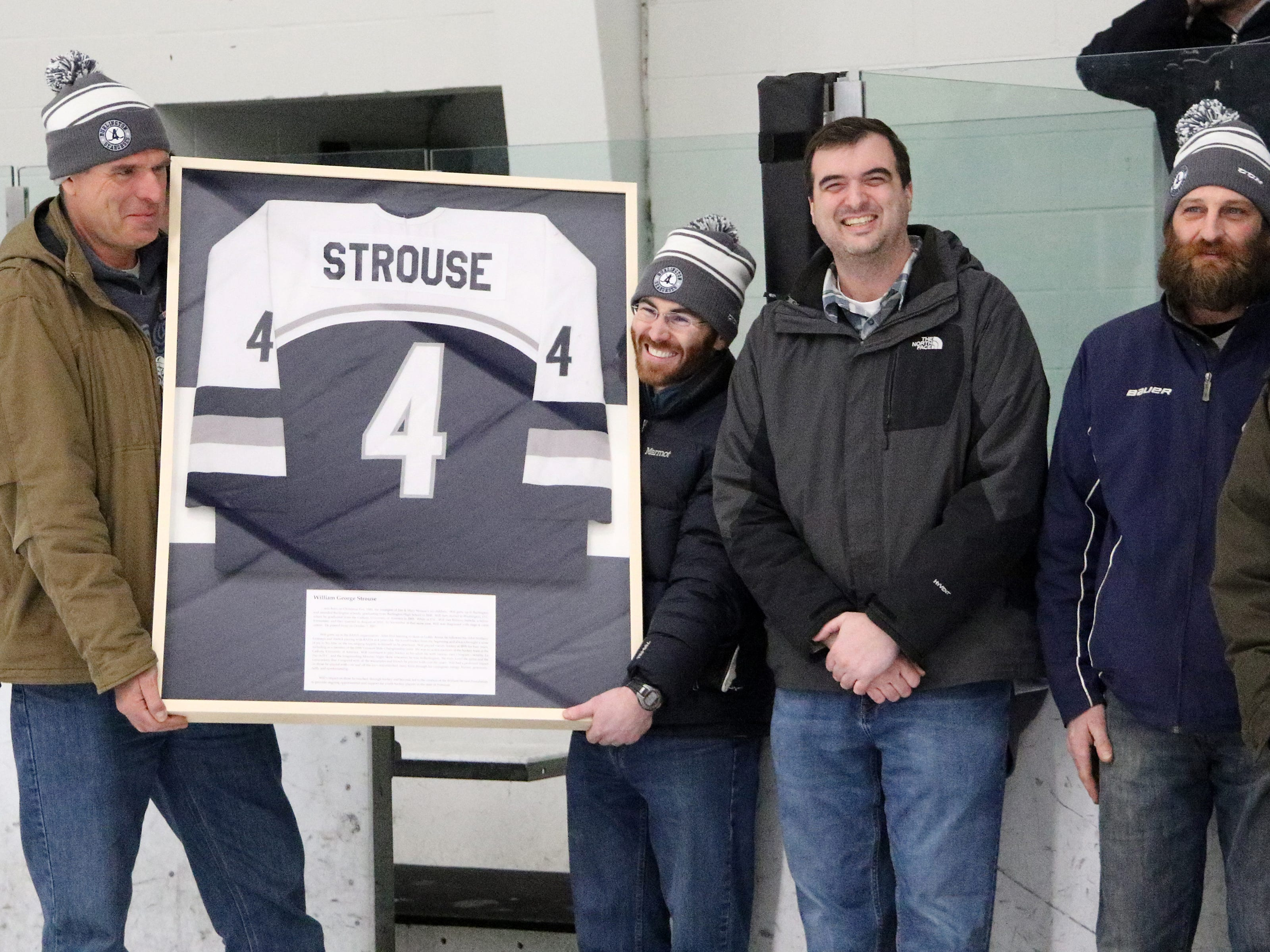 """Friends of the late Will Strouse present his High School Jersey to his family in a pre game ceremony honoring the former BHS hockey player before Saturdays """"BAHA Cup"""" game. Strouse passed away in 2017 from colon cancer and his jersey will now be displayed permanently at Leddy Arena. An annual Alumni and BAHA Cup game will also be played in his honor to help raise money for the """"Will Strouse Foundation"""". Please visit bahabobcats.com for more information about Will and the foundation."""