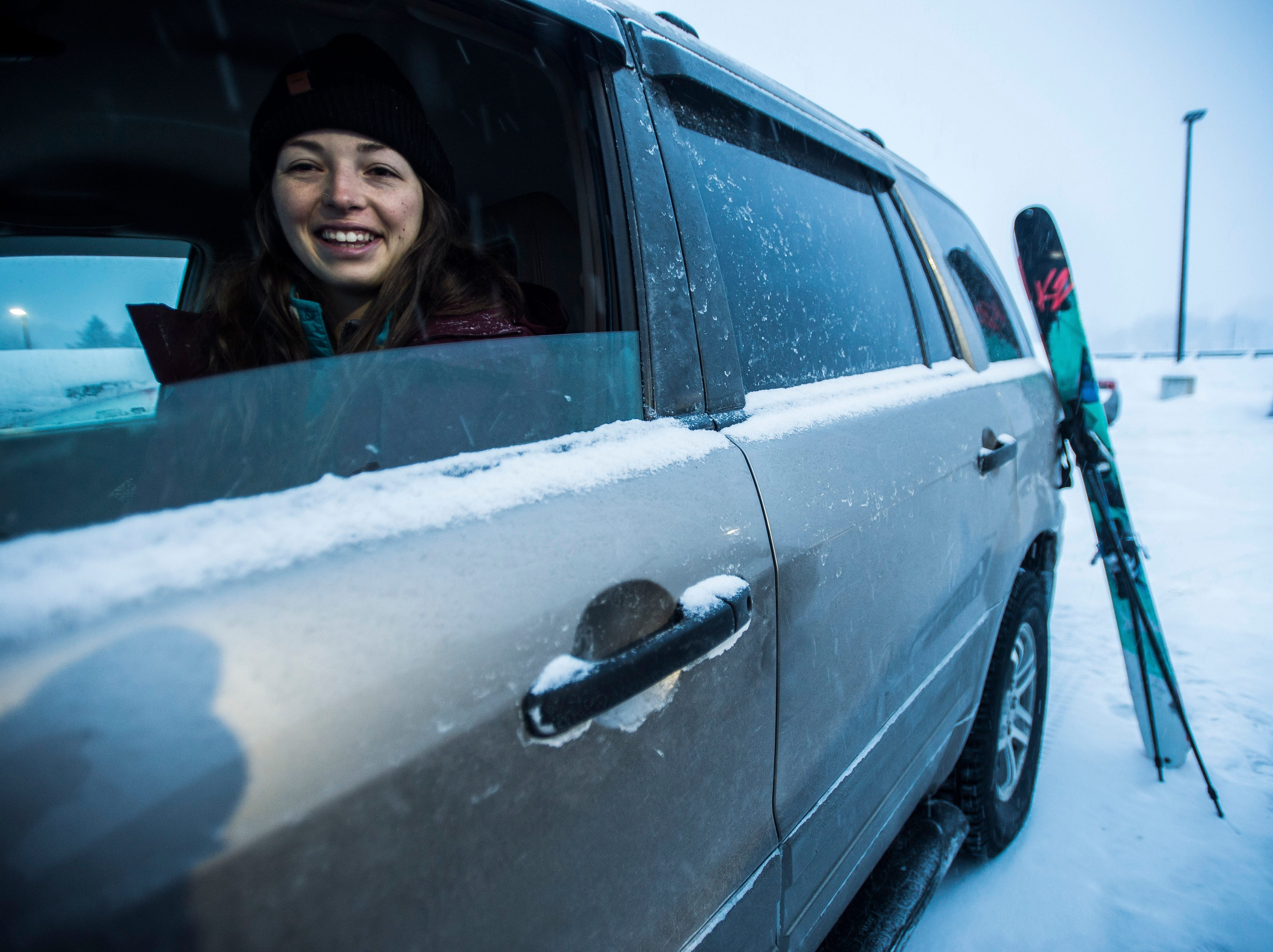 Stephanie Bronsther of Essex Junction, Vermont, is all smiles as she waits for a friend on the morning of Sunday, Jan. 20, 2019. Both planned to head to Sugarbush ski resort as Winter Storm Harper bore down on Vermont, dumping a forecast foot or more of snow in some areas.
