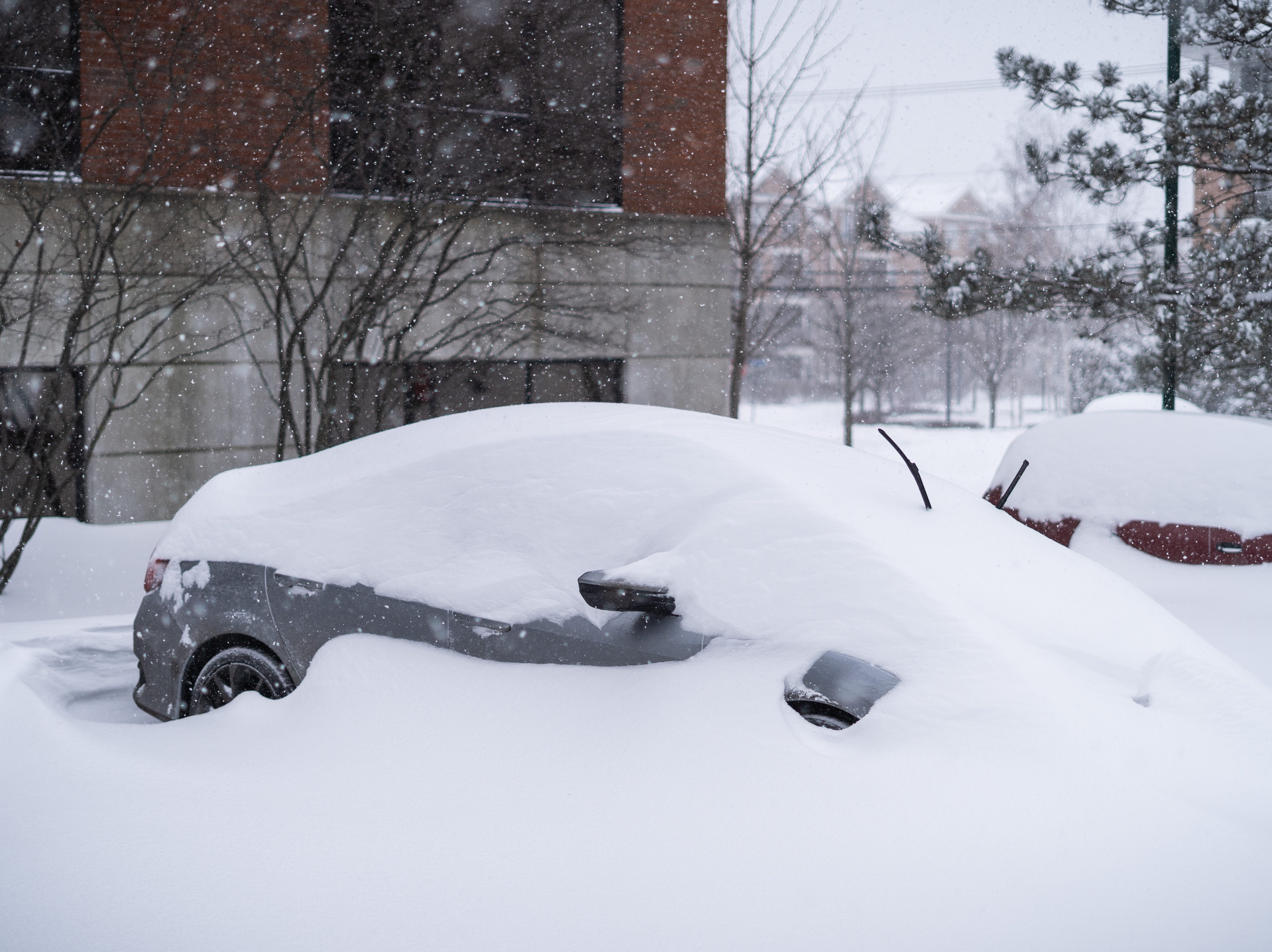 A car has been nearly entirely covered in snow on Sunday afternoon, Jan. 20, 2019, in South Burlington.