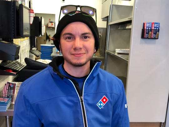 "Kristopher Hunt, of Graniteville, speaks during a pizza delivery shift Sunday afternoon, Jan. 20, 2019, at Domino's in South Burlington. ""I wore gaiters today in preparation of climbing through snowbanks,"" Hunt said, ""which has happened."""