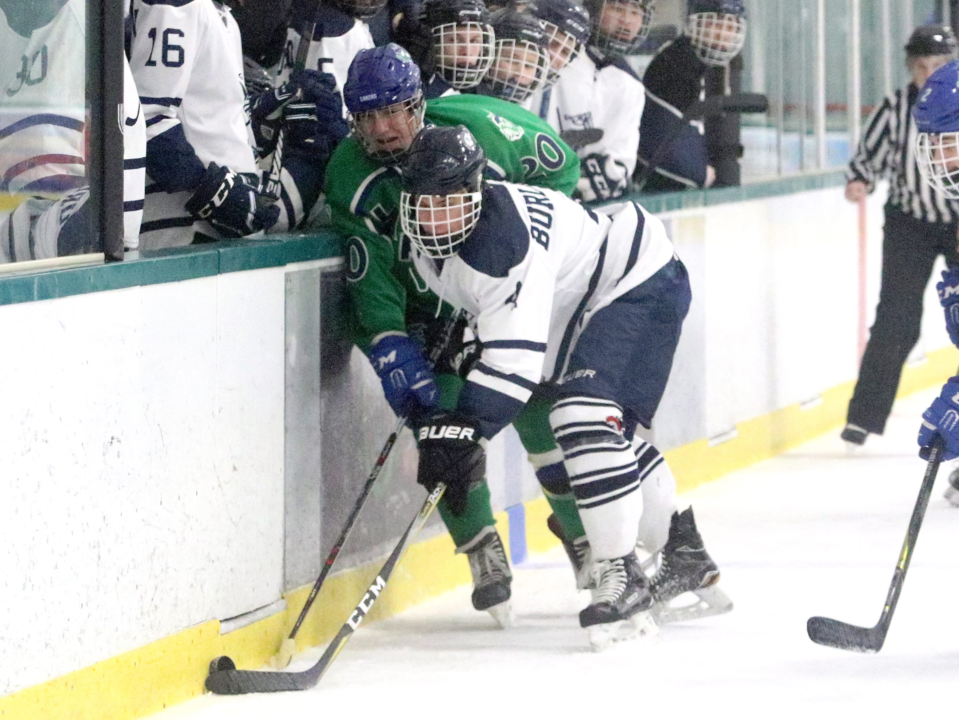 """Colton Poulin and Bodey Towle battle along the boards for the puck during the 2nd annual """"BAHA Cup"""" at Leddy Arena. Colchester defeated Burlington 6-0."""