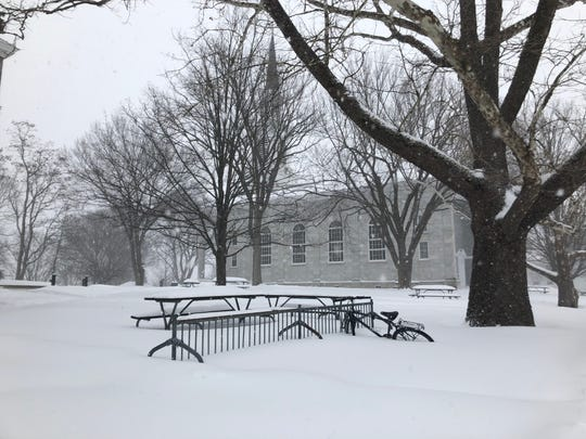 A buried bicycle sits outside Mead Chapel on the Middlebury College campus on Sunday afternoon, Jan. 20, 2019.