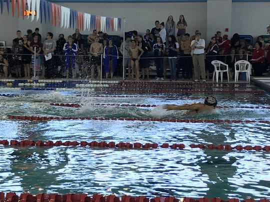 Flour Bluff's Alex Wallett creates separation in the boys 100 yard butterfly at the District 30-5A swim meet Jan. 19, 2018 at the CCISD Natatorium.
