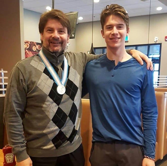 John Stevenson, left, has been mentoring 20-year-old Flyers goalie Carter Hart for half of his life.