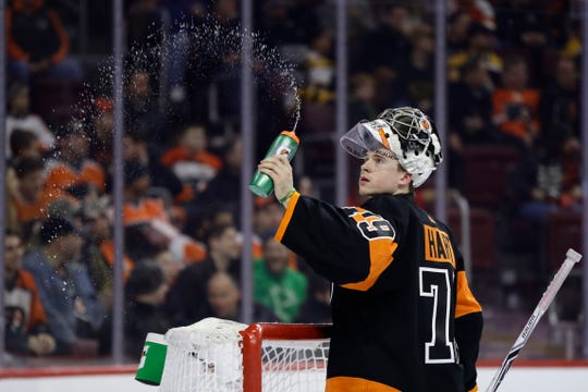 Part of Carter Hart's mental routine has been spraying a bottle and tracking a single bead of water as it falls to the ice.