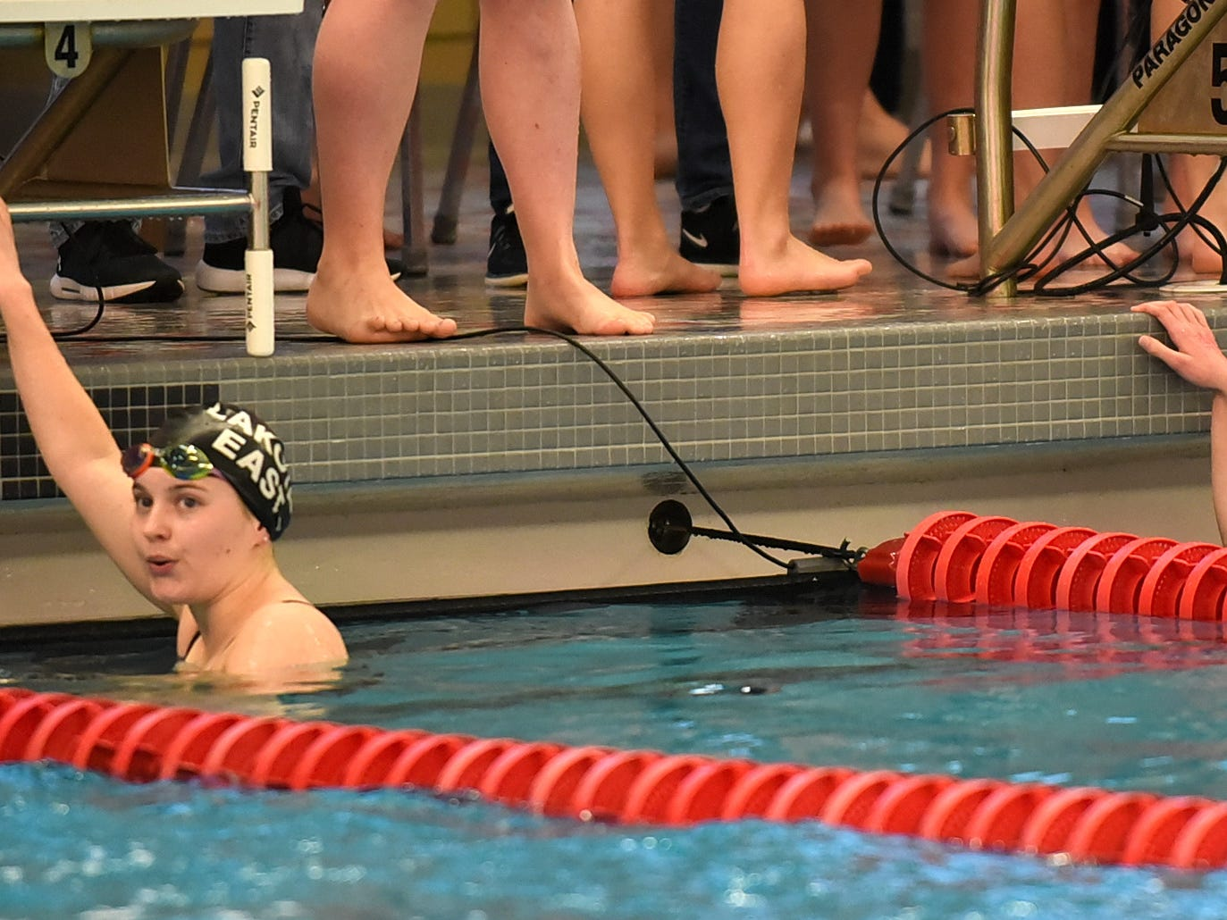 Grace Keith of Lakota East and Maliah Bricking of Summit look back to see there respective finish times while swimming in the girls 400 medley at the Southwest Ohio Swimming and Diving Classic, January 19, 2019.