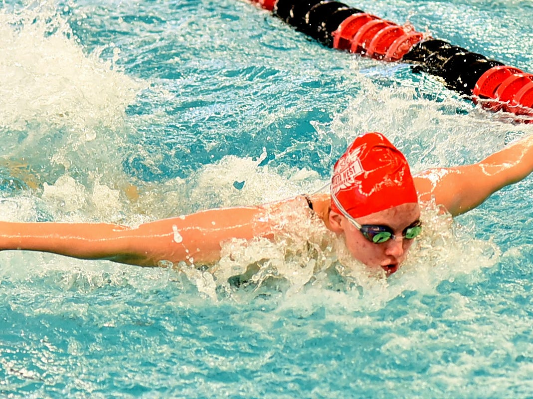 Paige Striley powers out the butterfly stroke in the preliminaries at the Southwest Ohio Swimming and Diving Classic, January 19, 2019.