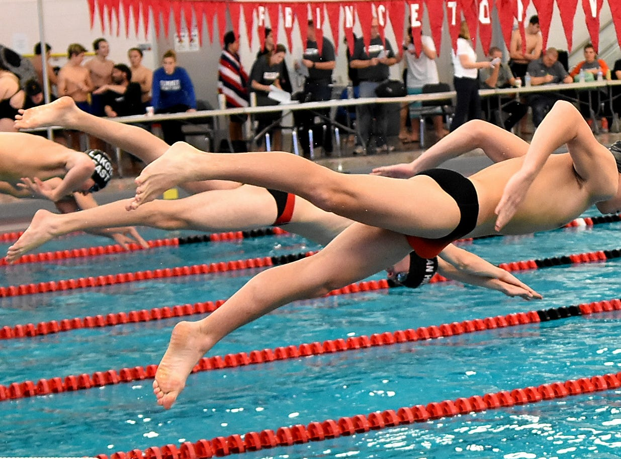 Trey Stutz of Lovelorn is airborne heading to the water in the ninth heat of the boys 50 freestyle at the Southwest Ohio Swimming and Diving Classic, January 19, 2019.