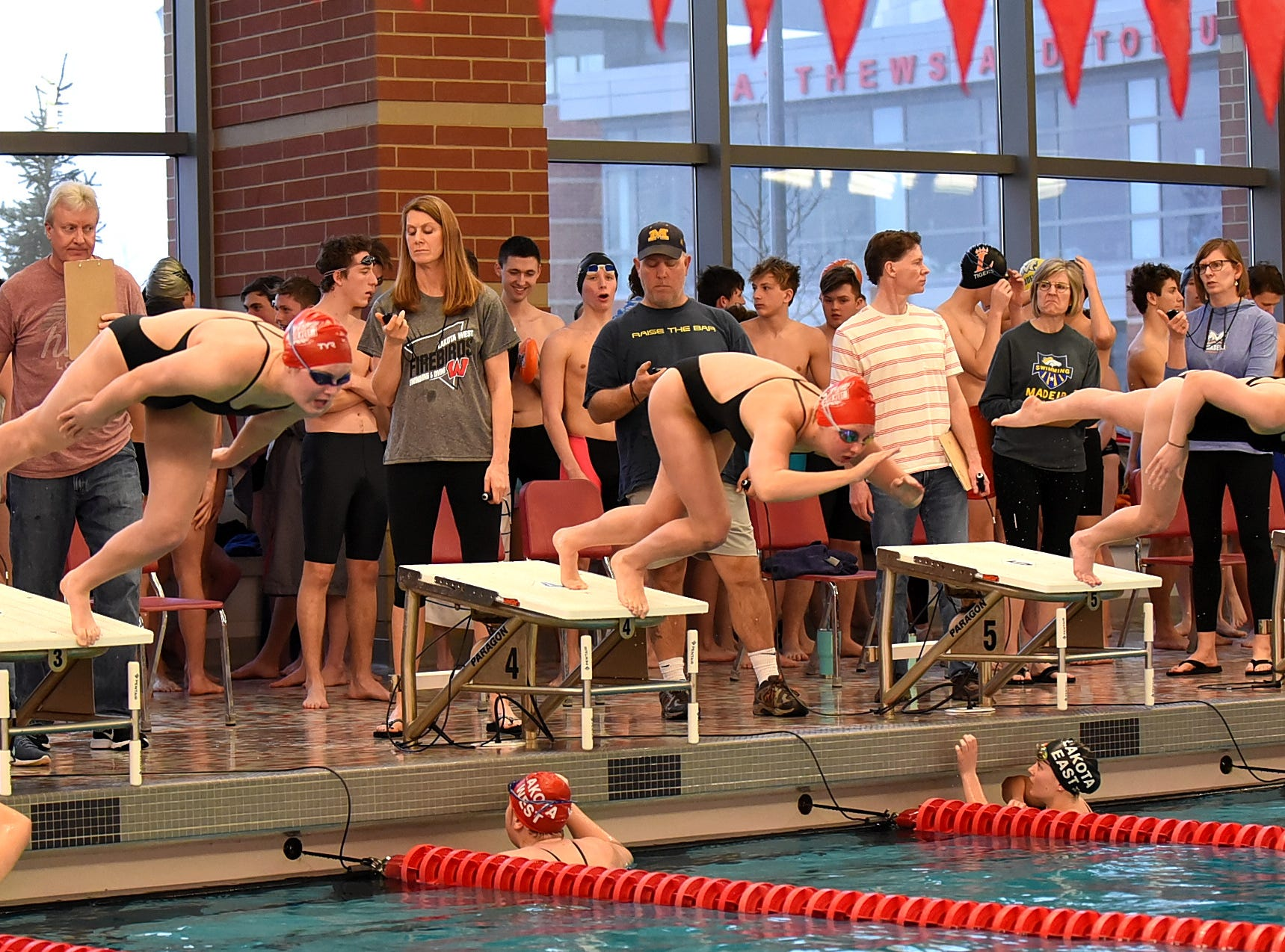 Ladies of Lakota West swiming in the final heat of the girls 50 freestyle take to the pool at the Southwest Ohio Swimming and Diving Classic, January 19, 2019.