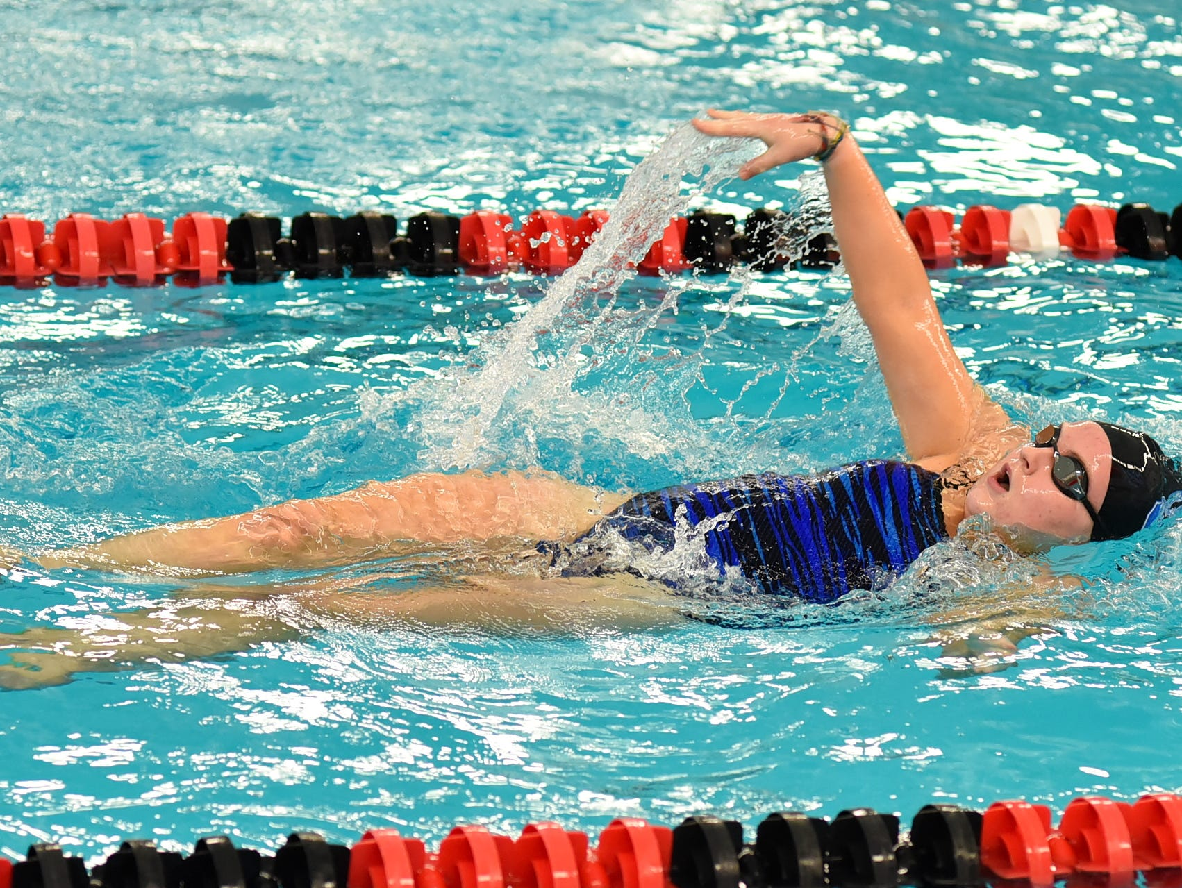 Summit's Grace Anderson drives home in the girls 100 backstroke at the Southwest Ohio Swimming and Diving Classic, January 19, 2019.