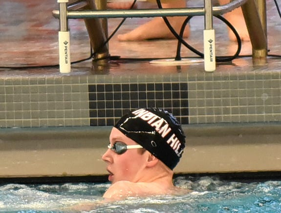 Devis Edwards of Indian Hill looks back to the clock to check his finish time in the last heat of the boys 200 freestyle at the Southwest Ohio Swimming and Diving Classic, January 19, 2019.