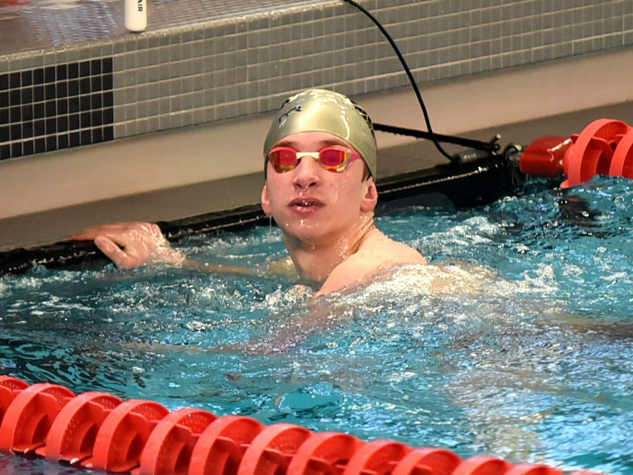 Adam McDonald looks up to see a first place finish in the boys 200 breaststroke at the Southwest Ohio Swimming and Diving Classic, January 19, 2019.