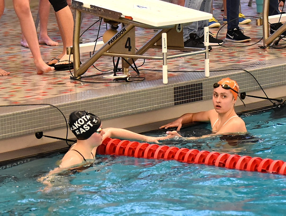 Hannah Cech of Lakota East and Grace Hastings of Anderson shake on a strong finish in the final heat of the girls 200 freestyle at the Southwest Ohio Swimming and Diving Classic, January 19, 2019.